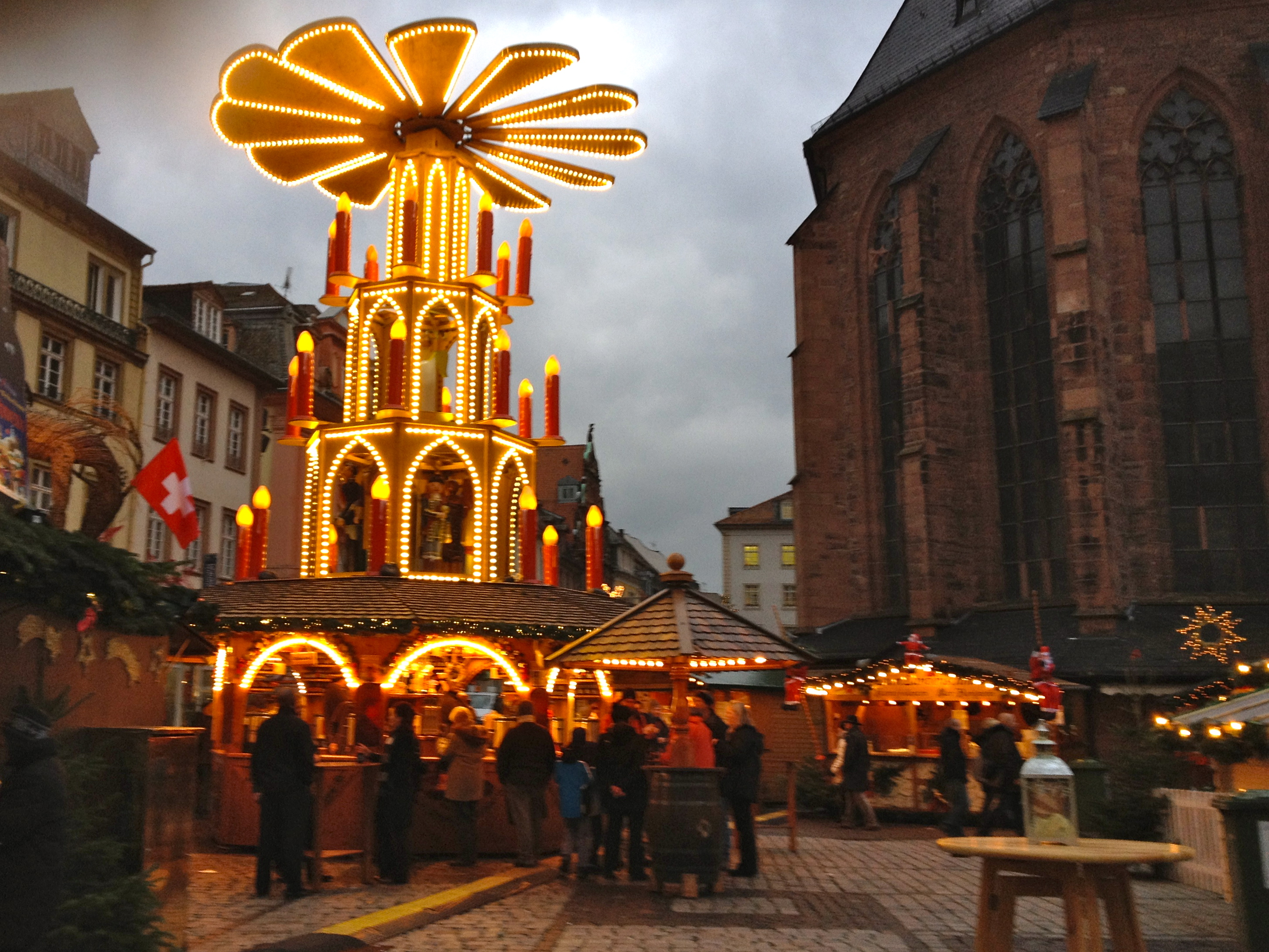 heidelbergs market winds through medieval streets and features a giant christmas pyramid